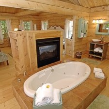 Whirpool bath with fireplace to enjoy at Murphin Ridge Inn